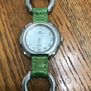 Accessories - Green and silver watch.